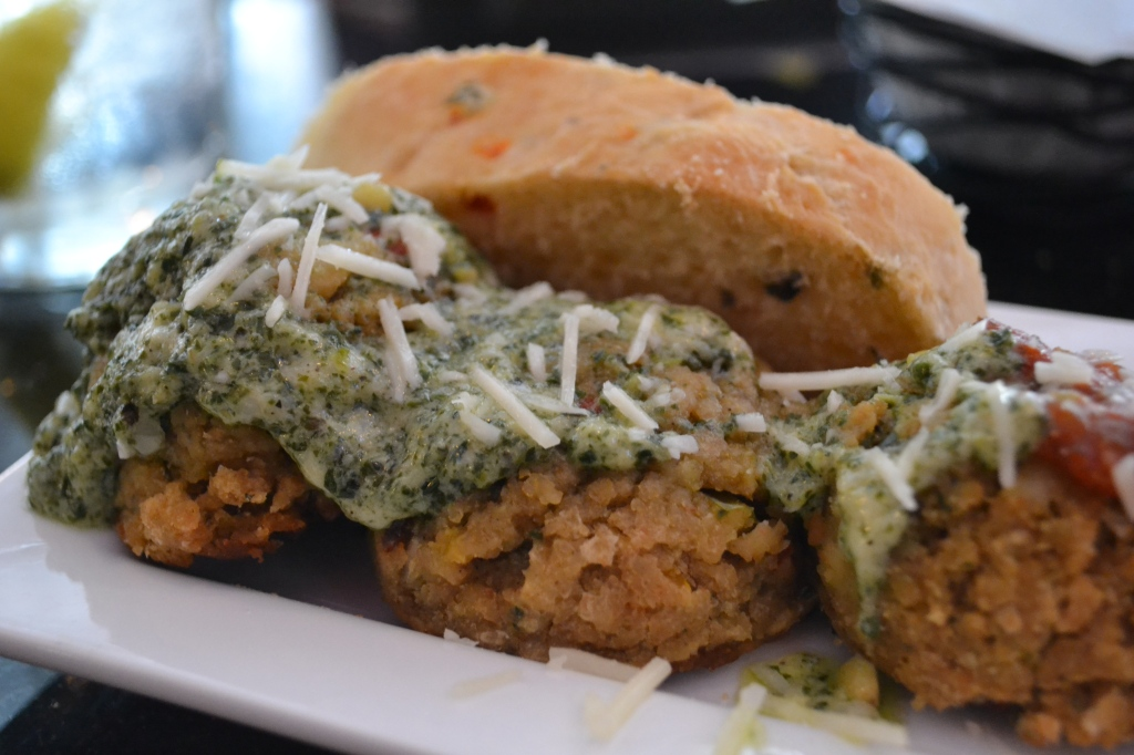 Veggie meatballs with creamy pesto sauce.